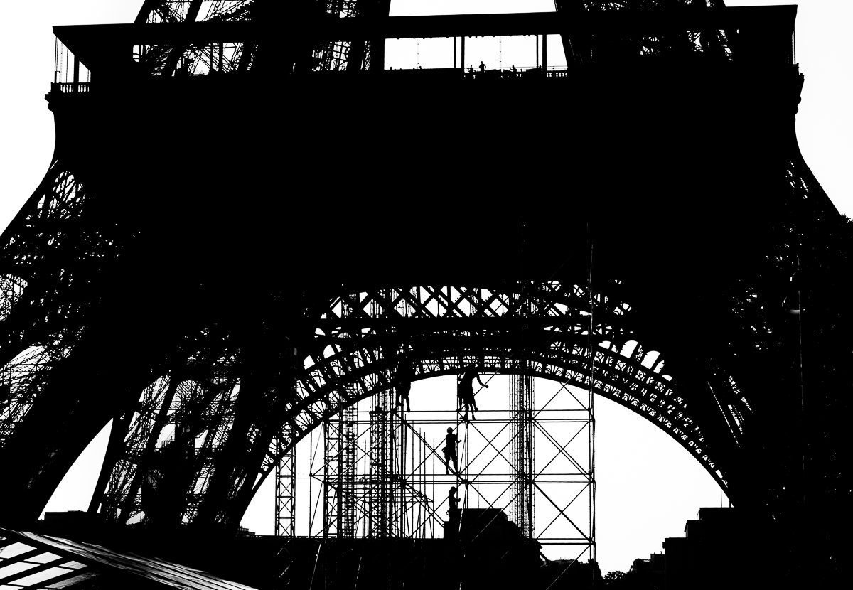 Workers at the Eiffel Tower, a unique travel experience