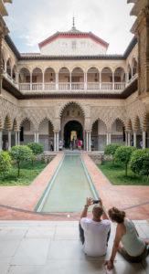 tourist v traveler - couple resting at Alcazar